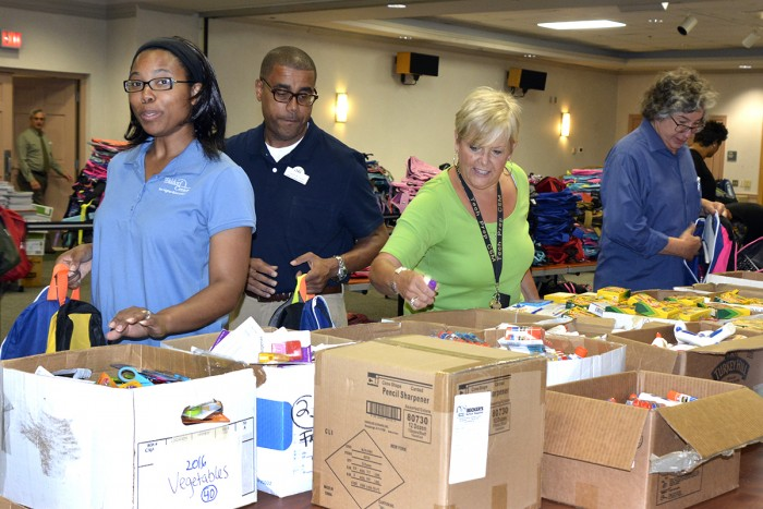 CSM folks pack 1500 backpacks with supplies for local students