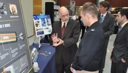 NSWCDD electromagnetic railgun system engineer,briefs a Navy captain