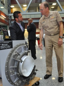 NSWCDD engineer Helmer Flores demonstrates how a shipboard Collective Protection System (CPS) fi ...